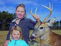Theresa and Sophia Pitman 01/01/2020  Mom, Theresa's, 8 point buck and Sophia 7 yrs old who took a doe